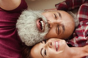 Happy mature couple lying together