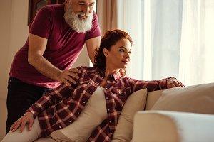 Bearded man hugging mature woman