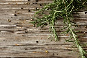 sprigs of rosemary with multi-colored pepper, selective focus