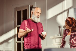 Man Talking with redhead woman