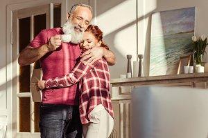 Happy mature couple hugging