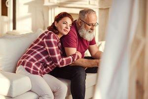 Mature couple sitting on sofa