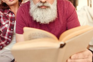 Bearded man reading book