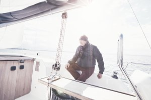 Aged man on sailboat