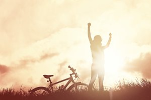 Winning girl with bicycle silhouette