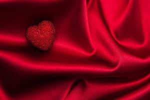 Red hearts on a red silk