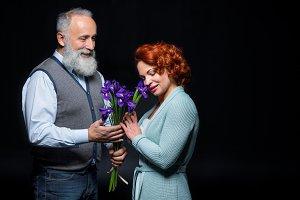 Mature couple with iris flowers
