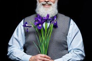 Senior man holding flowers