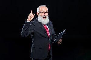 Senior businessman pointing up