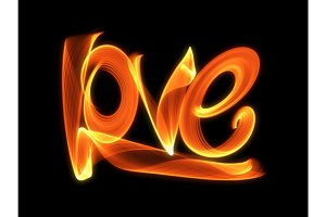 Love isolated word lettering written with fire flame or smoke on black background