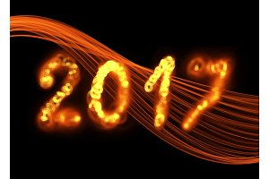 Happy new year 2017 isolated numbers written with flame fire sparkle light on black background elegant wave