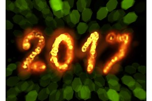 Happy new year 2017 isolated numbers written with flame fire sparkle light on black blurred bokeh background frame