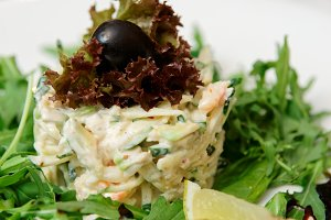 Seafood appetizer with rocket salad