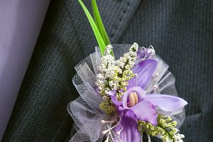 boutonniere flower in the pocket