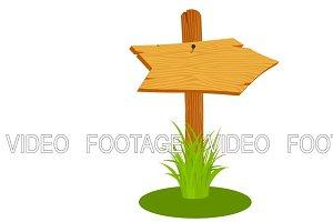 Wooden arrow on grass