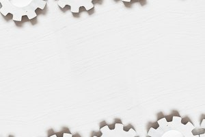White gears on a table, industry background, copy space