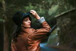 portrait of girl posing with hat outdoors