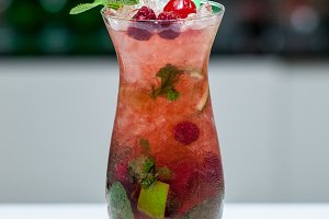 Berry mojito in a glass with ice