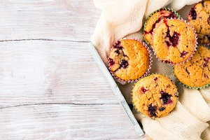 Berry muffins in wooden tray napkin breakfast