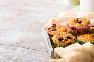 Berry muffins in wooden tray napkin breakfast