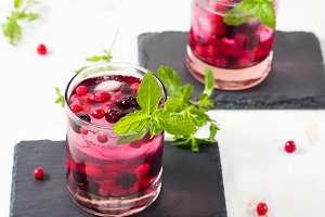 Fresh summer cocktail drink with berries and mint