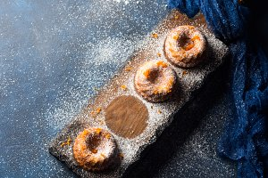 Bundt cakes on dark background and serving board