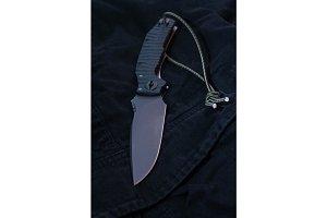Black knife on a background.