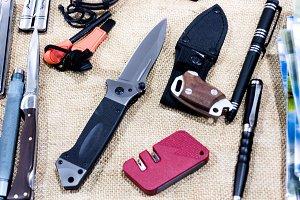 Tactical knife, pen, tools.