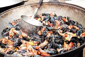Cooking mussels and crayfish.