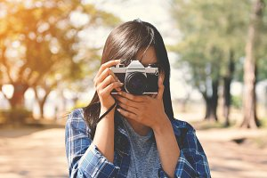 Asian women holding a camera