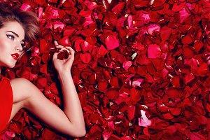 Girl in petals of red roses. #1