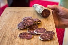 sliced sausage on a wooden board