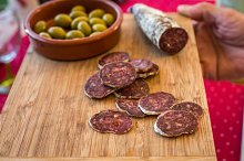 sliced sausage with green olives
