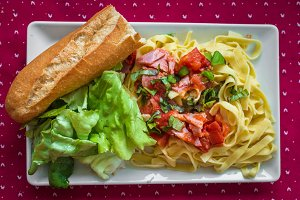 Salad with pasta, ham and vegetables
