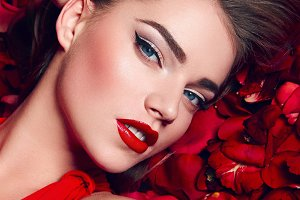 Girl in petals of red roses. #2