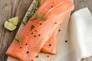 Raw salmon steaks on the wooden boar