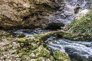 Ancient Bridge Over Cave River