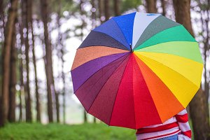 women with colorful umbrella