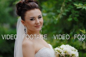 Beautiful brunette bride pose to photographer and smile