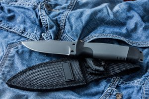 Fixed knife with case. Diagonal position. Clouse up.
