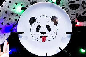 White plate with drawing pandas.