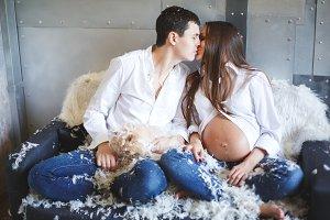 Young pregnant couple having fun