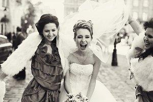 Bridesmaids raise bride's veil