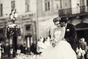 Bride looks very happy with a groom