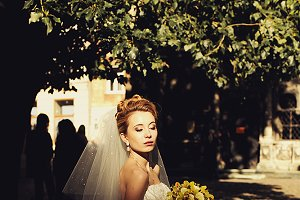 Bride stands with closed eyes