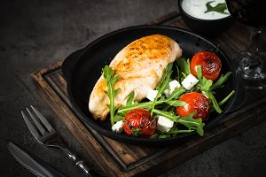 Grilled chiken fillet and fresh salad with.