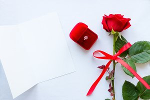 rose, wedding ring and greeting card
