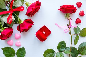 red roses and wedding ring