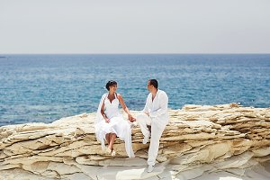 Bride and groom sit on the stones