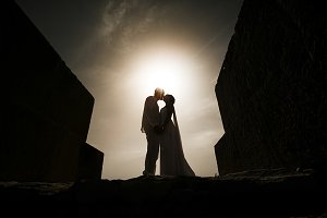 Silhouettes of kissing newlyweds